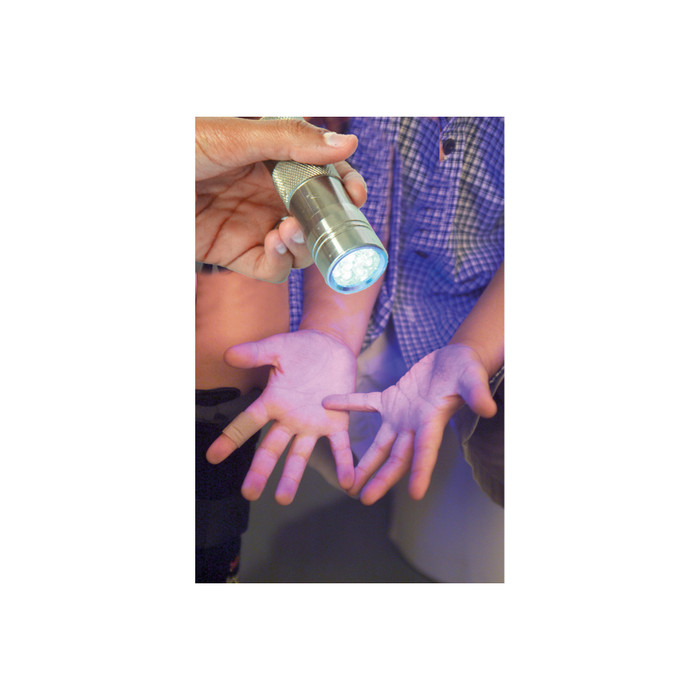 UV lamp used to show glowing Health Edco Germ Powder on a child's hands to teach hand washing importance, 79760
